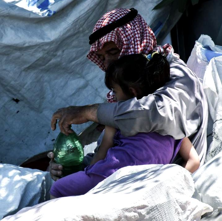 A Displaced Father and daughter in Syria